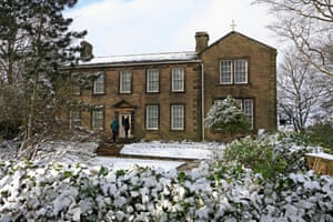 Two people visiting Bronte Parsonage Museum Haworth West Yorkshire England in winter