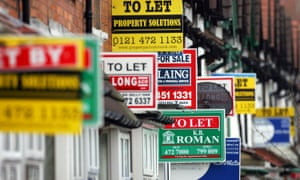 To let signs on a street of terrace houses