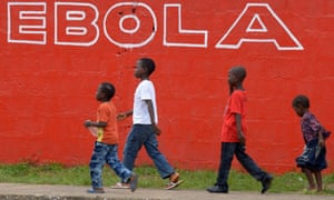 A graffito on a wall in Monrovia, Liberia, provides a warning in August 2014, at the height of the outbreak.