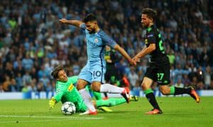 Manchester City's Sergio Aguero goes around Moenchengladbach's goalkeeper Yann Sommer to score their third goal and complete his hat-trick.
