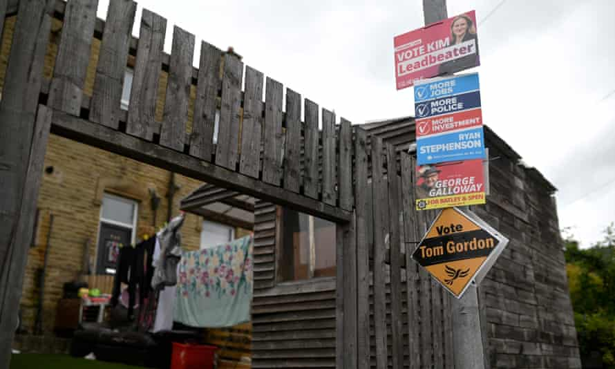 Election posters are displayed on a lamppost ahead of the Batley and Spen byelection