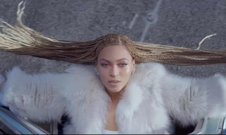 Beyoncé in a car, as seen in the video for her new single Formation.