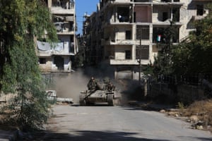 Syrian pro-government forces take part in an operation to take control of Aleppo's Suleiman al-Halabi neighbourhood, which is divided by the frontline that separates the rebel-held east and regime-held west of the northern city