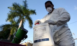 A health worker prepares insecticide before fumigating a neighborhood in San Juan on 27 January 2016.