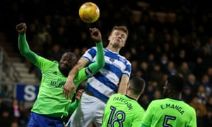 Matt Smith of QPR gets highest to score the equalising goal above Souleymane Bamba of Cardiff City.