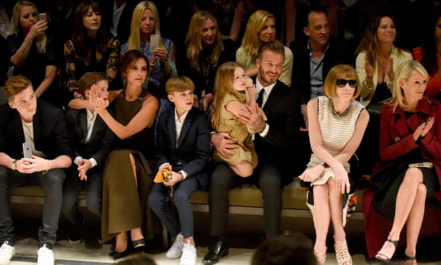 Victoria Beckham at a Burberry show in Los Angeles in April with her family. From left, Brooklyn, Cruz, Romeo, Harper, David, and the editor-in-chief of Vogue, Anna Wintour.