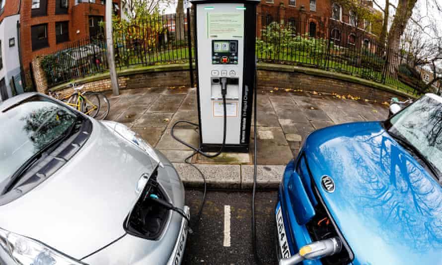 Go Ultra Low Nissan LEAF (L) and Kia Soul EV (R) on charge on a London street.