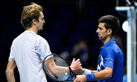 Novak Djokovic (right) shakes hands with Alexander Zverev after their round-robin ATP Finals match.