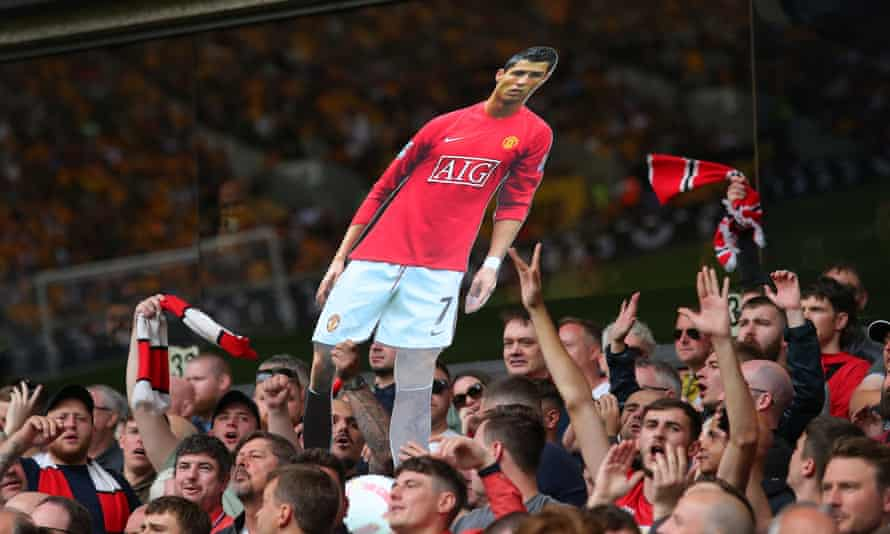 Manchester United fans display a cardboard cutout of Cristiano Ronaldo