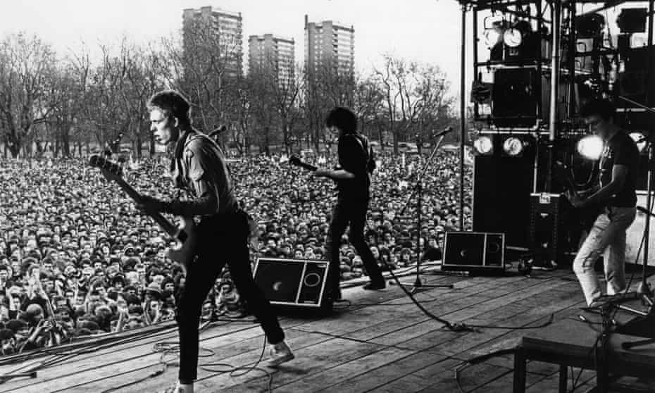 Photo of CLASH and Paul SIMONON and Mick JONES and Joe STRUMMERUNITED KINGDOM - APRIL 30: VICTORIA PARK Photo of CLASH and Paul SIMONON and Mick JONES and Joe STRUMMER, Paul Simonon, Mick Jones and Joe Strummer performing on stage at the Rock against Racism carnival held in Victoria Park Hackney, audience (Photo by Val Wilmer/Redferns)