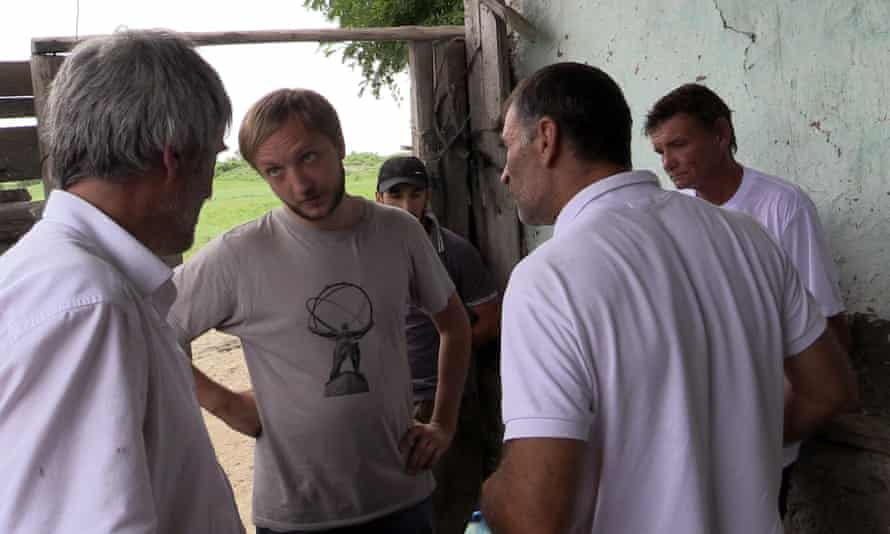 Alexey confronts a farm foreman over the liberation of a worker