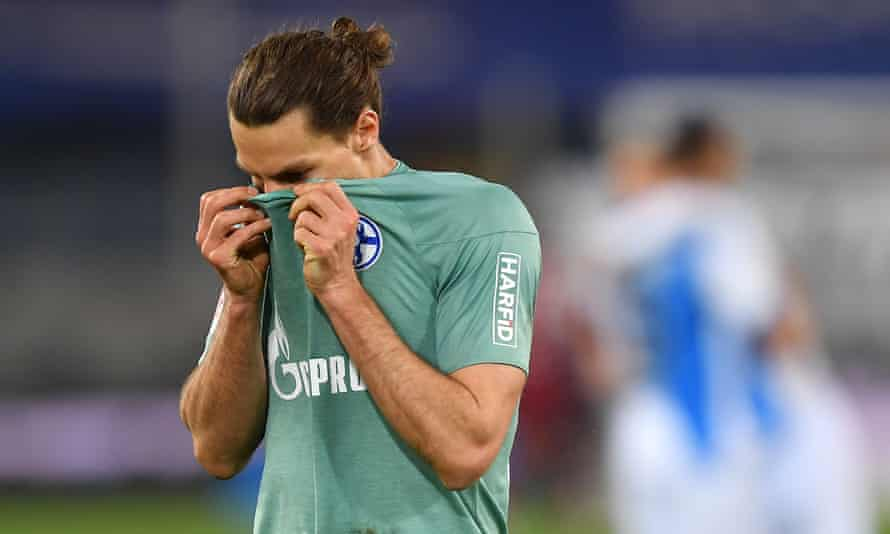 Schalke's Benjamin Stambouli reacts at full time to the confirmation of relegation