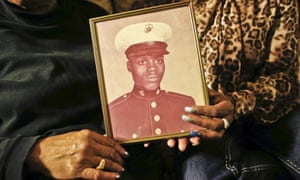 Alma Murdough holds a picture of her son, Jerome, a former Marine who died in a mental observation unit on Rikers Island in February.