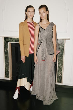 Beckham wanted to show an arresting mix of unusual colours, a crisp striped shirt mixed with contrasting blazer layered over a skirt and trousers. Simpler, a fluid silk satin dress.