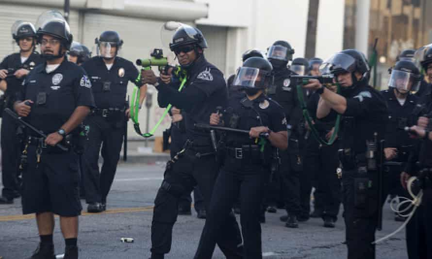 Los Angeles police officers fire rubber bullets during a protest on 30 May 2020.