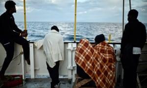 Migrants aboard rescue ship