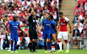 Pedro is shown a red card by Referee Bobby Madley.