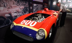 A Sotheby's employee dusts off the1956 Ferrari 290 MM by Scaglietti being exhibited in New York.