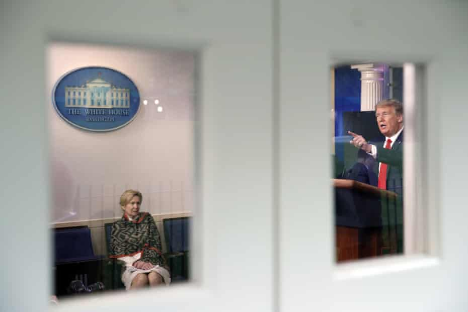 Donald Trump holds a press conference about the coronavirus at the White House on 13 April 2020 as Dr Deborah Birx listens.