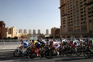 The peloton rides at the Pearl in Doha.