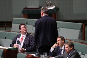 George Christensen talks with Nationals leader Barnaby Joyce during question time