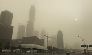 Cars in the central business district of Beijing during the sandstorm.