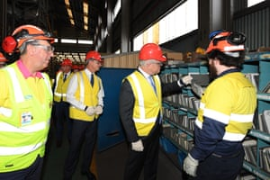 Prime minister Scott Morrison (second right) and minister for energy and emissions reduction Angus Taylor (second left) during a visit to BlueScope Steel in Port Kembla, NSW, today.