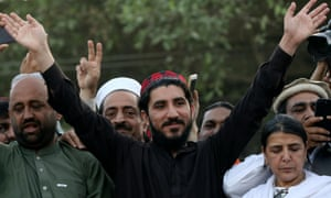 Manzoor Pashteen waves to supporters in Lahore
