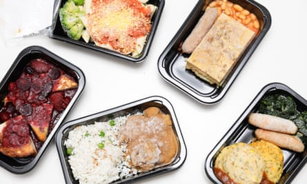 Frozen meals from Gate Gourmet. Clockwise from left: French toast with berries, penne with neapolitan sauce, potato and leak frittata, sweet potato and bacon fritters with sausage, beef rendang.