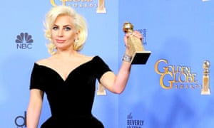Lady Gaga with her Golden Globe