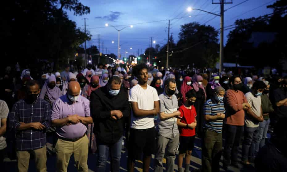 People pray following a vigil on Tuesday night after four members of a Muslim family were killed in London, Ontario, Canada.