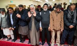 Muslims pray at the Al Furqan Islamic Centre in Glasgow