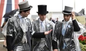Royal Ascot racegoers in wet weather gear