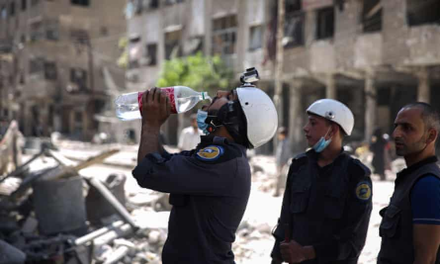 Syrian civil defence volunteers, known as the White Helmets, Douma, October 201