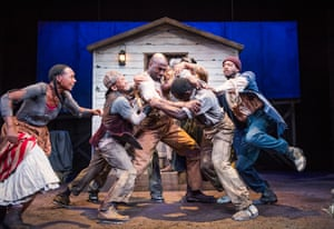 Steve Toussaint, centre, in Father Comes Home from the Wars (Parts 1, 2 & 3) by Suzan-Lori Parks, directed by Jo Bonney and designed by Neil Patel, in 2016.