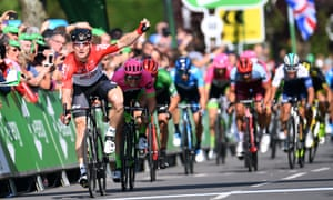 Andre Greipel crosses the finish line first as his competitors trail