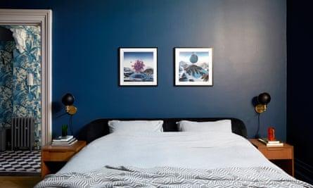 A bedroom with dark blue walls