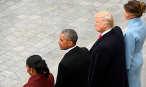 Barack and Michelle Obama stand with President Trump and Melania Trump at the inauguration. Repealing Obama's signature healthcare plan is high on the Republican agenda.