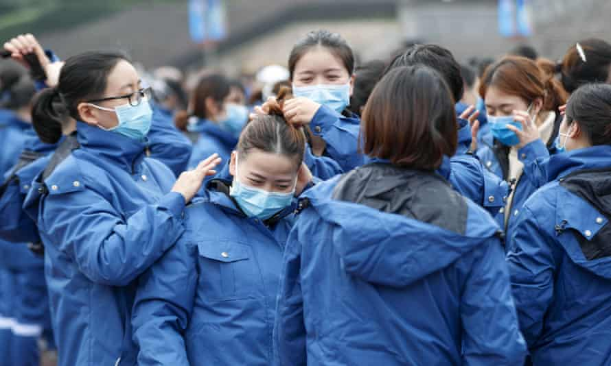 Medical team members from Chongqing before leaving for Xiaogan in Hubei, the latest city to order residents to stay in their homes, or face detention of up to 10 days.