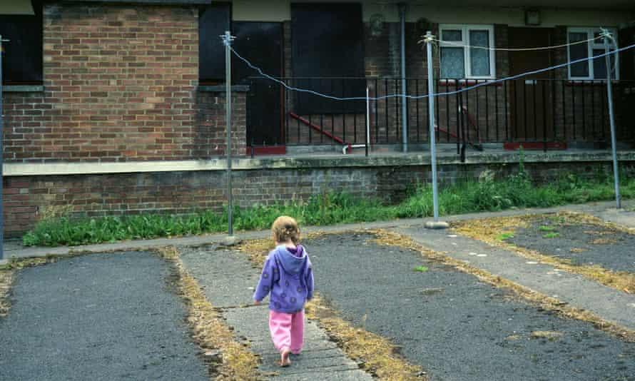 Child plays near housing estate
