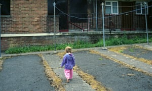 A young girl playing in a council estate in Bristol