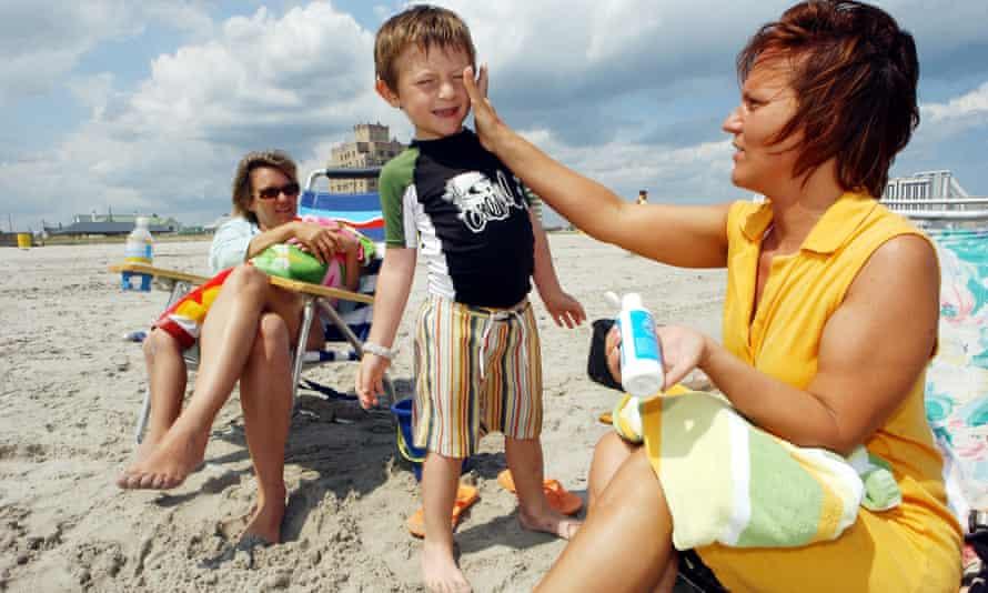 Family applying sunscreen