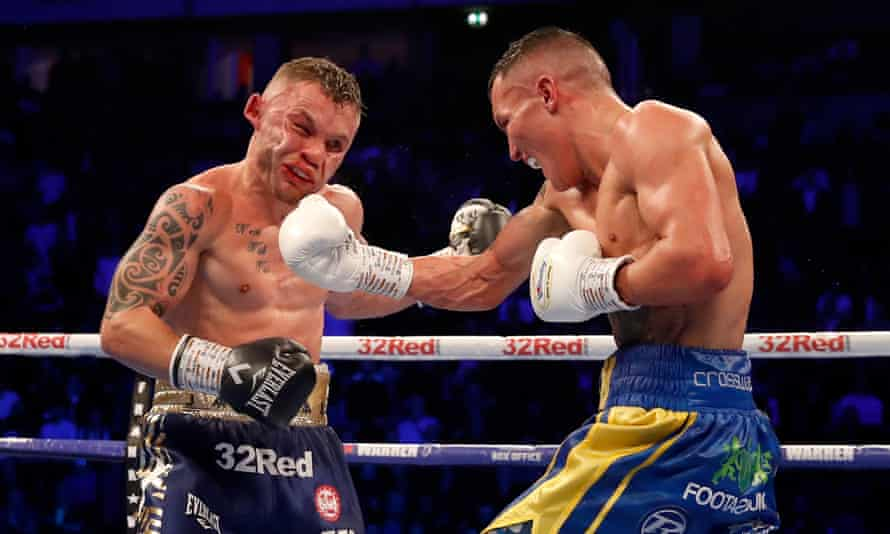 Josh Warrington (right) lands a punch on Carl Frampton during their epic contest