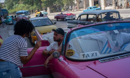 Tourists who have just disembarked from a cruise liner speak to a taxi driver in Havana, Cuba Tuesday.