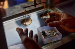 A local buyer weighs the gold
