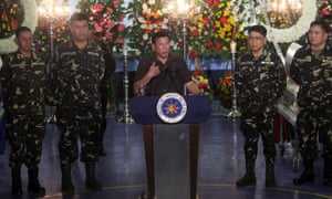 President Duterte speaking at the memorial for a soldier killed in an encounter with communist rebels.