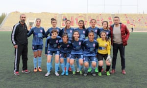 Dogan Deniz Celebi (far right) and Ikranur Sarigul (standing, fourth from right) with the Malatya Women's Sports Club football team in the world capital of apricots.