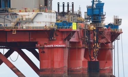 Greenpeace climbers on the BP oil rig in Cromarty Firth, Scotland