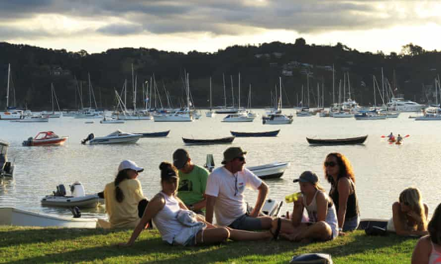 people relaxing at a marina in new zealand