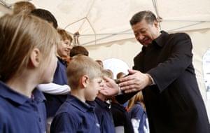 Xi meets a children's choir in Kehrsatz, Switzerland during his visit to the 2017 Davos forum.